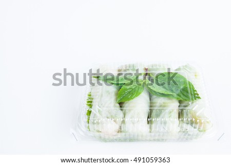 Spring rolls wrapped chicken with boiled cabbage leaves in plastic box.