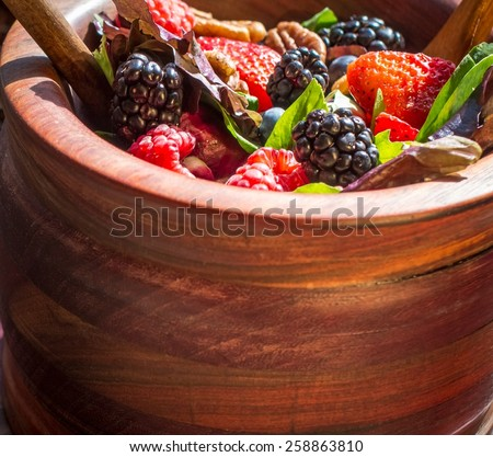 Spring Salad. Blackberry, blueberry, strawberry, pecans and greens make a healthy, nutrient packed and delicious salad. - stock photo