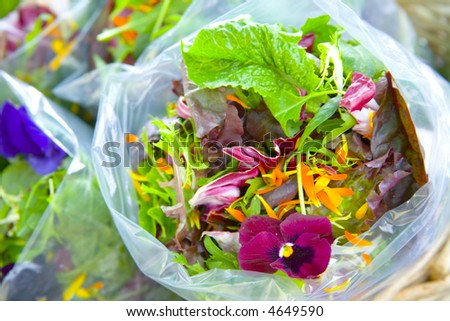 Spring Salad Mix with Edible Flowers - stock photo