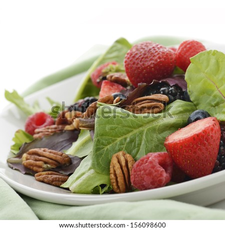 Spring Salad With Berries And Peanuts,Close Up - stock photo