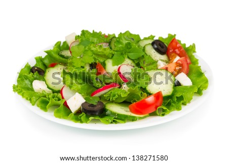 Spring salad with fresh vegetables and olives - stock photo