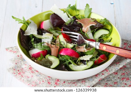 Spring salad with ham and cheese - stock photo