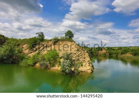 Spring scene on rocky lakeside - stock photo