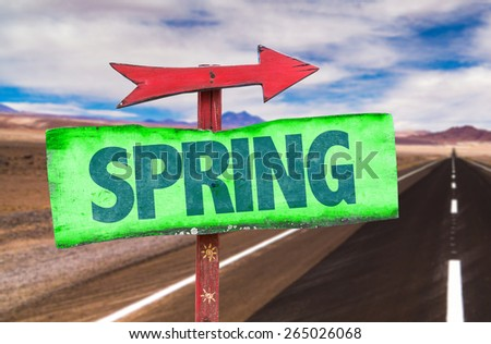 Spring sign with road background
