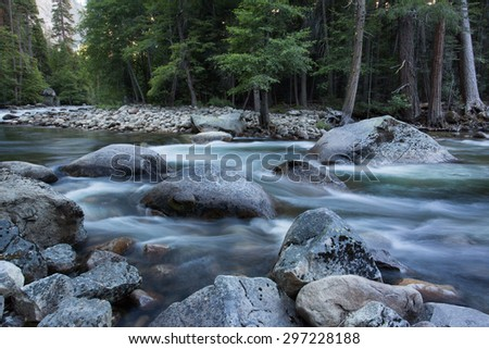 Spring snow melt flowing in the Merced River near Happy Isles, Yosemite National Park, California - stock photo