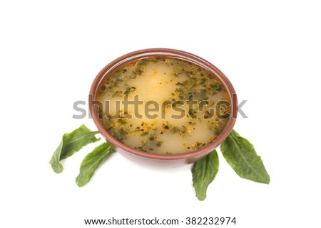 Spring soup with sorrel leaves - stock photo
