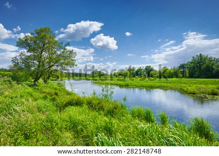 Spring summer river landscape blue sky clouds countryside - stock photo