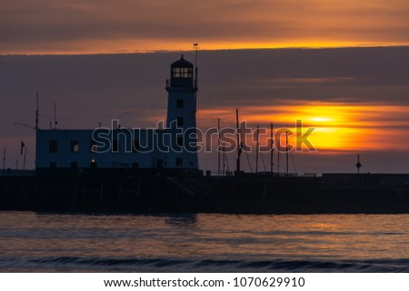 Spring sunrise by the Lighthouse at South Bay, Scarborough, North Yorkshire.