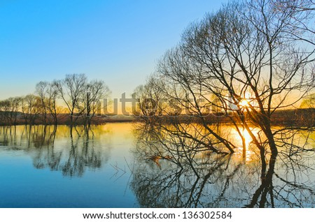 Spring sunset. Flood of River Protva. Kaluga region. Russia - stock photo