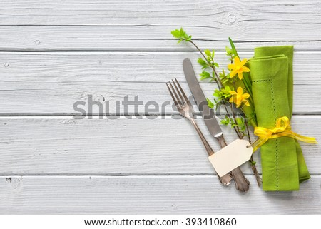 Spring table place setting with daffodils. Holidays background - stock photo