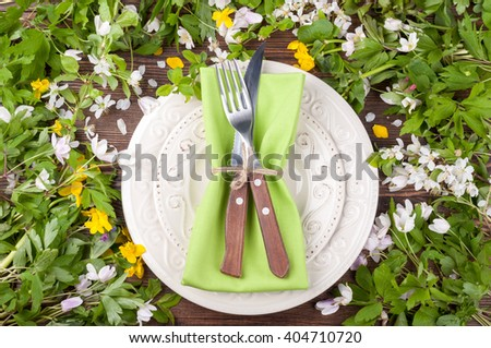 Spring table settings with flowers and cutlery. Floral wedding table settings in rustic style. Top view - stock photo