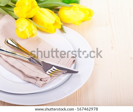 Spring table settings with fresh tulips - stock photo
