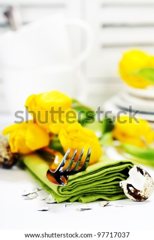 spring table settings with fresh tulips - easter concept - stock photo