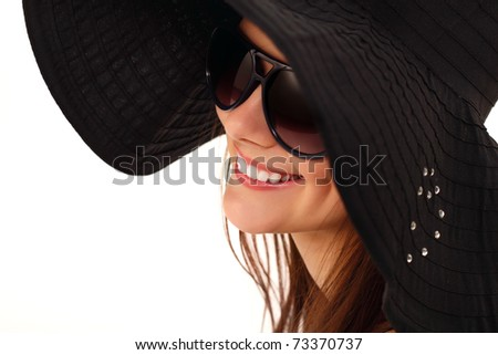 spring teen girl cheerful in panama and  sunglasses enjoying isolated on white background