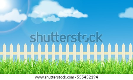 Spring theme - fresh grass, white wood fence and a sunny sky