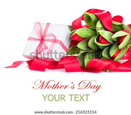Spring Tulip Flowers bouquet and gift box over white. Mother's Day or Easter Tulips bunch decorated with red satin ribbon. Floral Border Design. Isolated on a white background - stock photo