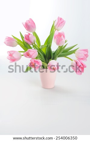 Spring tulips in a bouquet in a vase  - stock photo