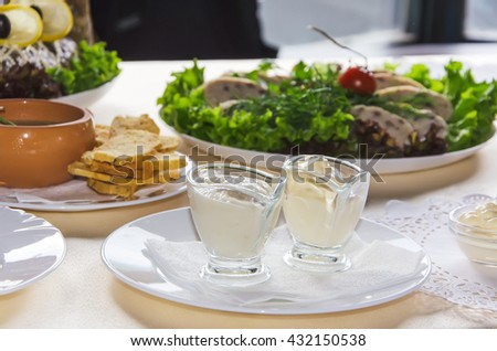 spring vegetables with mayonnaise on the table - stock photo