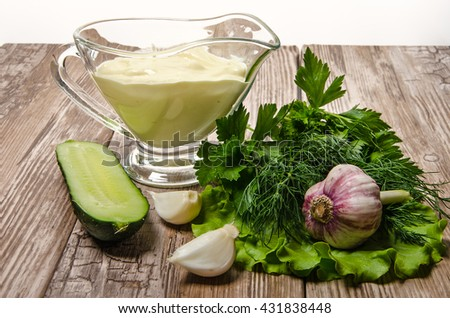 spring vegetables with mayonnaise on wooden table - stock photo