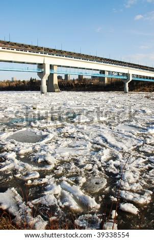 Spring view of north saskatchewan river with melting ice, edmonton, alberta, canada