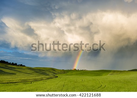 Spring weather, storm and sunset over the meadows of Tuscany. - stock photo