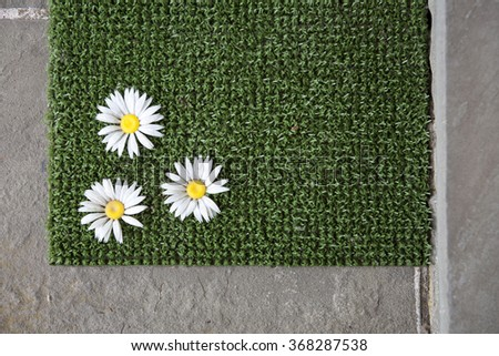 Spring welcome mat - stock photo