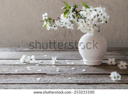 spring white flowers on wooden background - stock photo