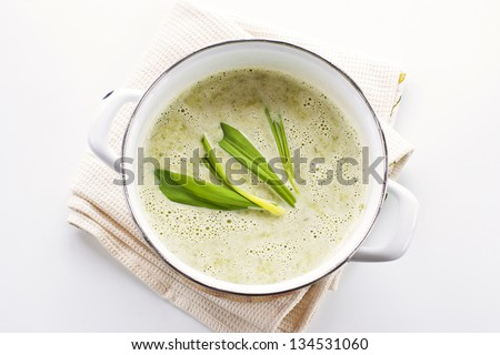 Spring wild garlic soup on white background - stock photo