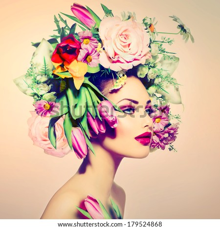 Spring Woman. Beauty Girl with Flowers Hair Style. Beautiful Model woman with Blooming flowers on her head. Nature Hairstyle. Summer. Holiday Creative Makeover. Fashion Makeup. Make up. Vogue Style  - stock photo