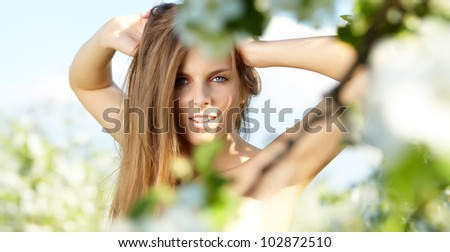 Spring woman in summer dress walking in park - stock photo