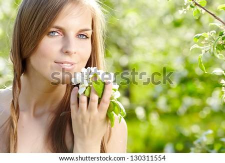 Spring woman in summer dress walking in park enjoying the sun. - stock photo
