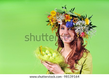 Spring woman with nest - stock photo
