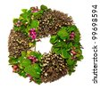 spring wreath with leaves and berrys - stock photo