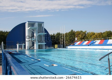 Springboard for jumps in water in sports pool - stock photo
