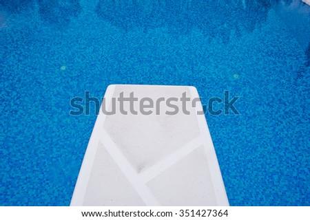 Springboard in the pool - stock photo