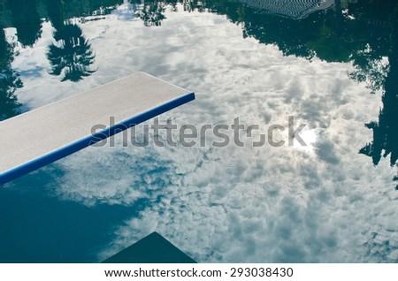 springboard  on swimming pool. - stock photo