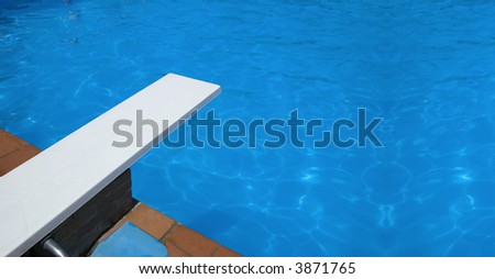 Springboard to dive at swimmingpool - stock photo