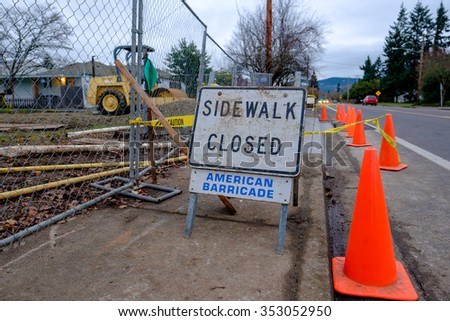 SPRINGFIELD, OR - DECEMBER 16, 2015: New sidewalk construction in front of a housing development on 5th Street in Springfield Oregon.