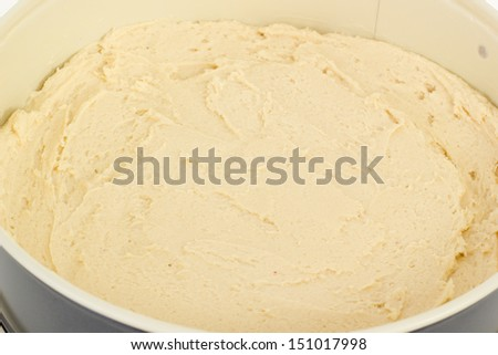 Springform pan filled with cake dough - stock photo
