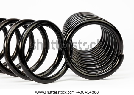 Springs automotive black. Automotive suspension coil spring on the white background. Concept - stock photo