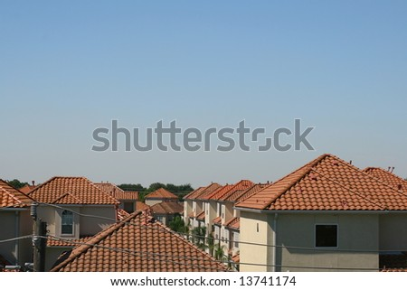 Springtime: Houses with Orange Spanish Roofs against Rich Blue Sky