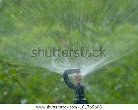 Sprinkler for agricultural watering system. - stock photo
