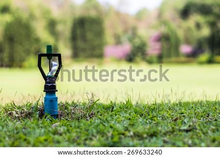 sprinkler green garden - stock photo