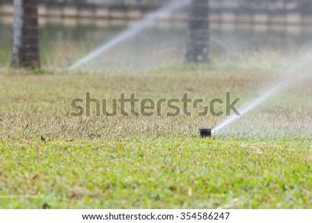 Sprinkler in park ,Garden irrigation system watering lawn