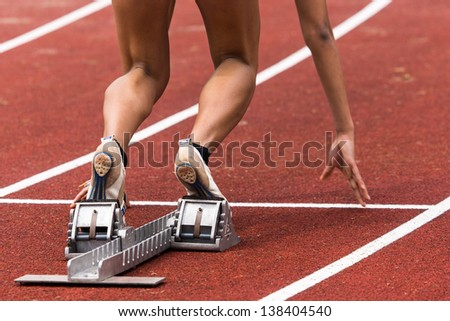 sprint start in track and field - stock photo