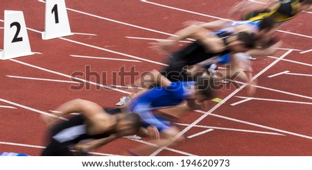 sprint start in track and field in blured motion