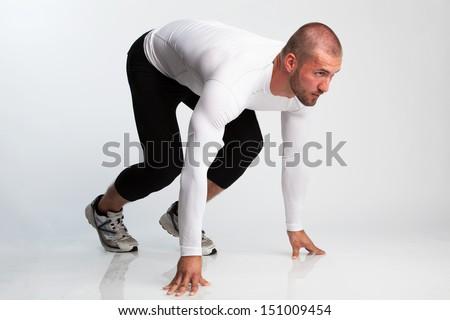 Sprinter in Starting Position - stock photo