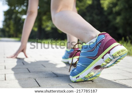 Sprinter start position on the track. Jogging sport