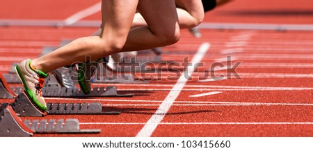 sprintstart in track and field - stock photo