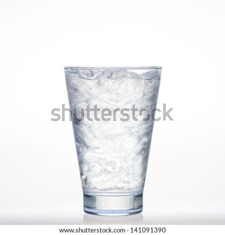 Sprite drinks whit sparkllng soda and ice in glass isolated on white - stock photo